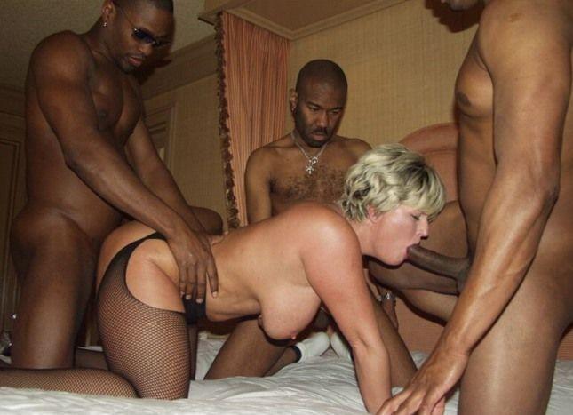 Three men having sex with one woman