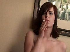 Teen smokes and rubs her tits