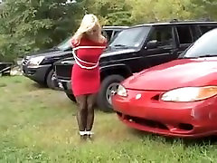 Blonde in red dress tape gagged