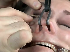 Hooks in nose make tied up chick moans with pain