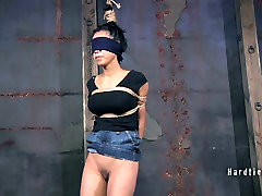 Blind folded gal gets punished with long stick in the basement