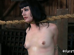 pale titless brunette has to stand in attention position with gag in mouth