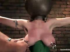 Mega busty porn model is punished in torture room