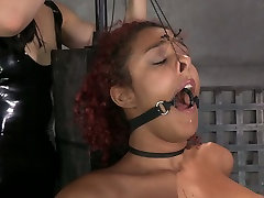 Restrained red haired ebony in stockings chick gets her cunt punished