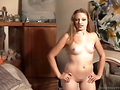 Whorish long hera haired chick shows off her fat ugly ass on camera
