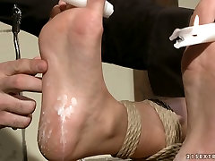 Submissive girl with flat tits is getting tortured with hot wax