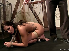 Seductive babe is giving stout blowjob while her hands are tied up. BDSM