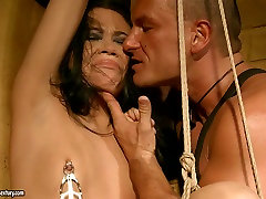 skinny brunette girl is fucked hard from behind while tied up in standing position. bdsm