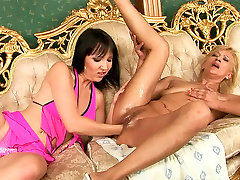 Sextractive red-haired mom gets her moist pussy fisted by young lesbian