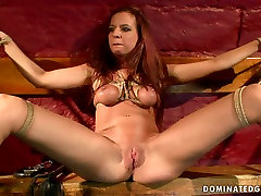 Whorish red-haired chic gets her tits tied with rope in amatrice extreme sex scene