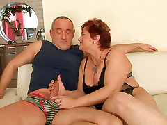 Bosomy fat mature gives a skillful blowjob to horny dad