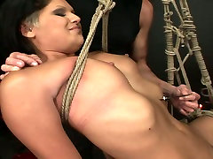 Perverted brunette hooker is tied up with rope in dirty kira whipping porn clip