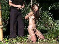 Joyful black haired Asian babe enjoys her ultimate bondage 18 year ke game