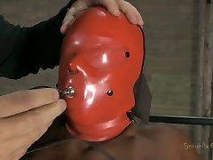 Ebony chick Ashley Starr wears slave hood and gets treated in helpless massage therapy way