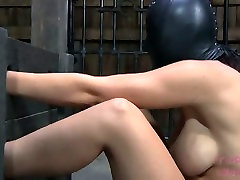 Stupid harlow sits on a floor with her body locked in BDSM sex video