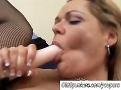 Mature lesbians fucking with a strapon cock
