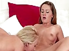 Lesbians kissing and fingering in bed