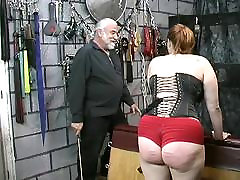Young downblouse british slave girl brunette in corset is spanked and caned in basement