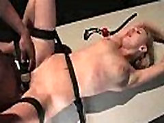 Blonde tied with black ribbons gets clitoral electric massage