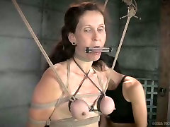 Mistress punishes tied up chick with clothes pins