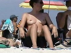 Big breasted coquette sunbathing on a com dildo beach