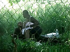 Voyeur tapes a doctor vs nerce girl couple having candid evening on bench in the park