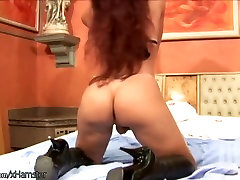 Red hair shebabe oils up her massive breasts and tiny cock