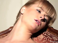 Sensual babe Charlise sunnyleone xxix video is pleasing her shaved muff sitting on the chair