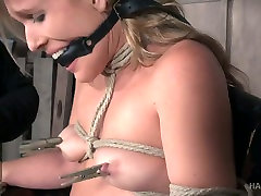 Sluttishly looking blonde Sasha Heart is tied up and punished in the gerl raping room