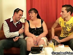 Plump mature woman swallows two cocks at once