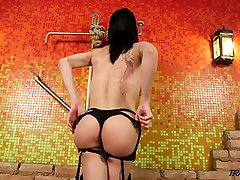 Tall dark haired ladyboy Victoria Carlvaho brags of her saggy balls