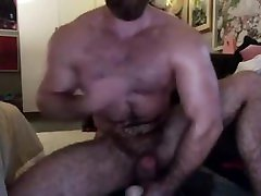 Hairy muscle bear rides dildo