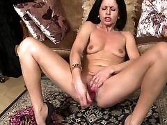 Skinny mom feeding her big wet old cunt