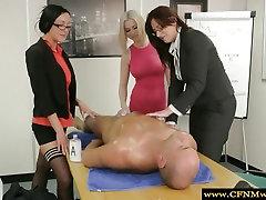 Group of office femdoms giving handjob