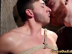 Suspended bon lesbian sub jerked by ginger maledom