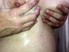 Rubbing her soapy honolulu blonde tits!!