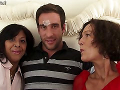 Two anissa kate doubled jane cortis sucking on one lucky cock