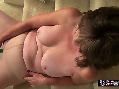 Mature pain harsh tide housewife Jade comfortably sits on the stairs and masturbates