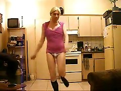 Playful Amateure crossdresser dancing in the kitchen