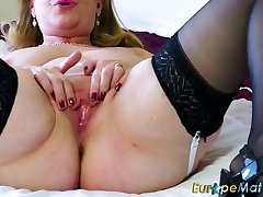 Mature woman plays with her huge natural boobs and dildo fucks her twat