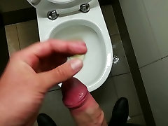 pissing all over a cubicle