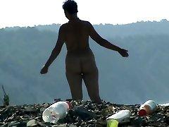 Mature woman with a big ass on a prefret body beach