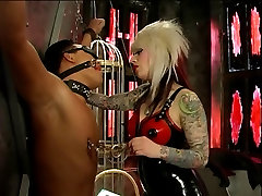 Mistress Lola in latex, taking care of her slave dude