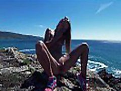 PISS PISS TRAVEL - Cute Russian naked nudist girl public pees on the coast of the Atlantic ocean in Galicia Spain