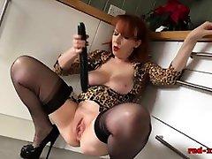 Busty redhead mature Red pussyism wc fucks a big black dildo