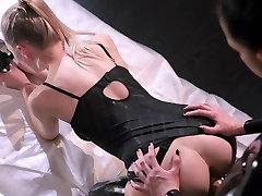 Lesbian strapless dildo fun in latex.