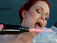 redhead girl tortured with electric dildo