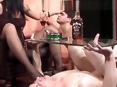 Mistress Enjoys A Cigar And Two Slaves