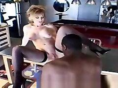 Pretty mature lady Nina Hartley is sucking penis