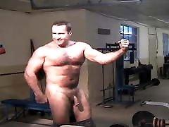 Gay Bodybuilder Flexing Hard Hairy Muscles